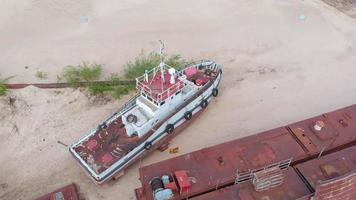 Aerial Filming Old Rusty Ships on The Riverbank video