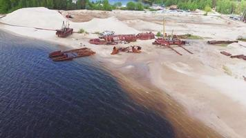 Aerial Drone Footage of Old Rusty Ships on The Riverbank video