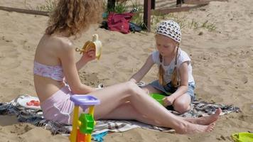 Mother and Daughter Enjoying the Beach video