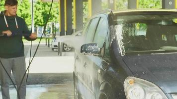 The process of washing the car in a selfservice car wash video