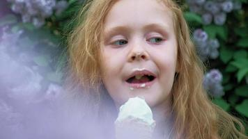 Little girl eats ice cream outdoors Summer video