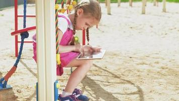 preschool girl use mobile devices outdoors video