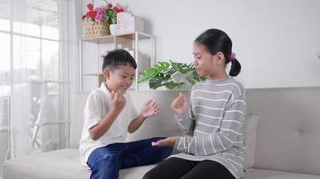 Two kids playing rock, paper, scissors game and laughing video