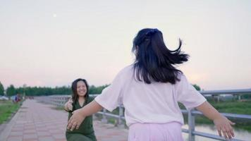 Asian Kid running to her mom and hugging her video