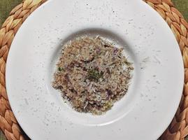 Italian cuisine rice with porcini mushrooms photo