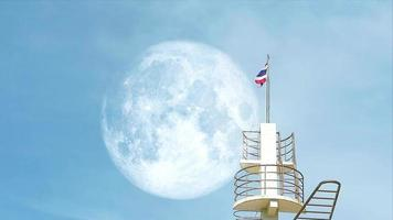 full moon and top light house on the morning in the summer, focus to the moon video