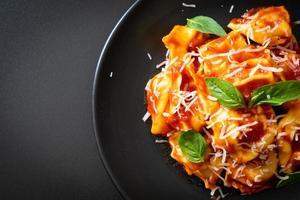 Italian tortellini pasta with tomato sauce photo