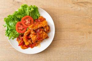 Fried fish topped with 3 flavors chili sauce photo