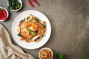 stir-fried Chinese noodle with basil, chilli, shrimps and squid photo