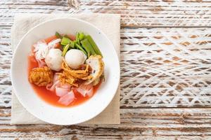 Thai Style Noodle with assorted tofu and fish ball in Red Soup photo