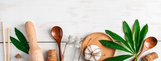 Eco-friendly recyclable products on white wooden background. Plastic-free kitchen accessories. photo