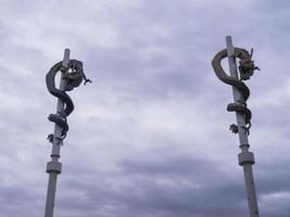 Stone deagons on pillars. Sokcho city, South Korea. photo