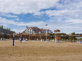 Turkish beach and the big hoter in the background. Antalya city. Turkey. Spring 2017 photo
