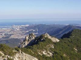 The view from the peak to beautiful mountains ans Sokcho city. Seoraksan National Park. South Korea photo