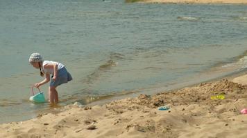Preschool Girl Walks on The River Shore video