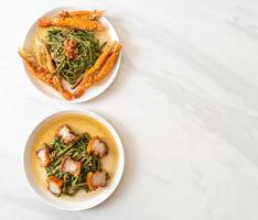 Stir-fried water mimosa with crispy pork belly and river prawns photo