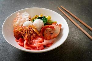 Dry Thai Style Noodle with assorted tofu and fish ball in Red Soup photo