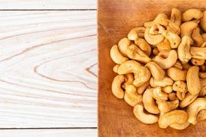 Cashew nuts in wooden bowl photo