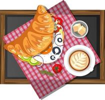 Breakfast croissant sandwich with a cup of coffee on a wooden plate isolated vector