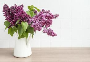 Bouquet of lilac flowers in a vase photo