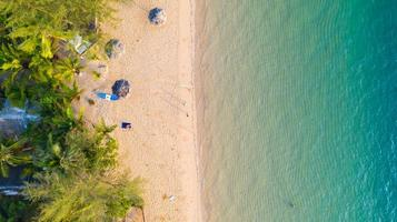 Aerial view of Beach with shade emerald blue water and wave foam on tropical sea photo