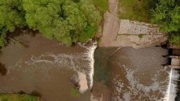 Dam on the river. Waterfall, Strong current, Aerial filming video