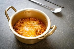 Korean spicy instant noodle with cheese photo