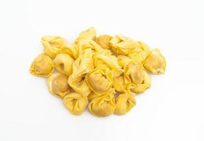 Italian traditional tortellini pasta on white background photo