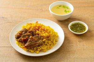 Beef Biryani or Curried rice and beef - Thai-Muslim version of Indian biryani, with fragrant yellow rice and beef photo