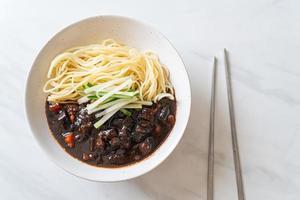 Jajangmyeon or JJajangmyeon is Korean Noodle with Black Sauce photo
