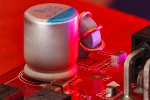 Electronic Printed Circuit Board with Electronic components in red photo