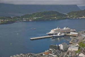 Cruise ship docked in Alesund in Norway photo