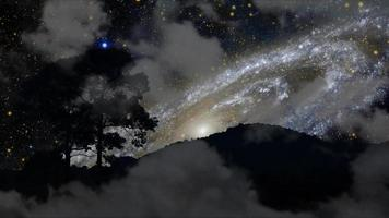 Galaxy moving back silhouette mountain and tree with dark cloud on the night sky time lapse video