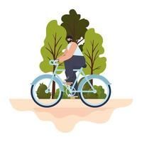 Hombre sobre una bicicleta morada en un parque vector
