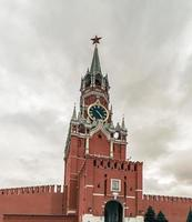 Spasskaya Tower of the Moscow Kremlin on a cloudy day. photo