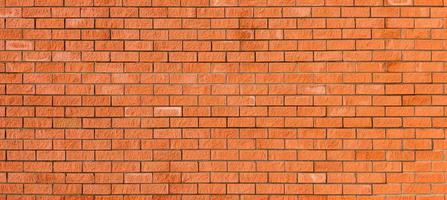 Red new brick wall, wide panorama of masonry. Ideal background for any projects. photo