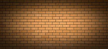 A brick wall with a light spot in the centre and a shadow at the edges. Perfect background for emphasizing important ideas. photo