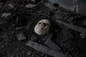 abandoned white ceramic mask photo