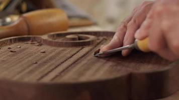 In Woodcarver Shop Cuts the Mahogany Board with a Chisel and Makes a Pleasant ASMR Sound video