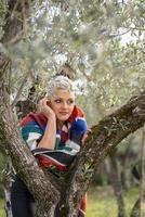 portrait short hair blonde girl among the nature photo