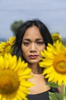 Indian girl among sunflower flowers photo