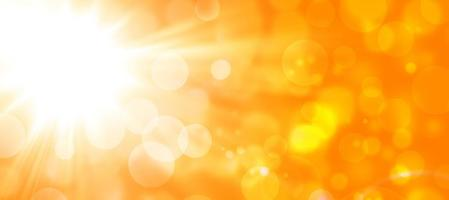orange autumn abstract background with sun and bokeh photo