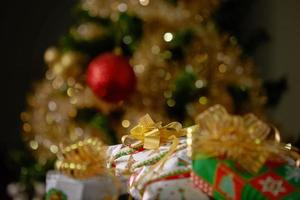 Stacks of Christmas Presents Under a Christmas Tree photo