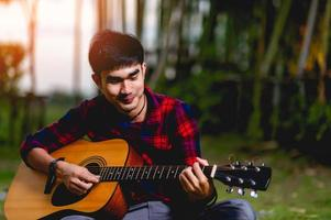 Man with guitar outside photo