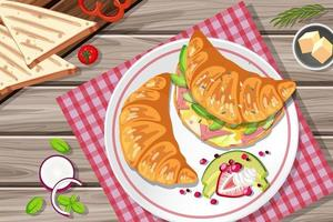 Breakfast croissant sandwich with vegetable and egg on the table vector