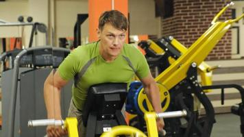 Man works out at the gym on simulators. Sport and Health lifestyle video
