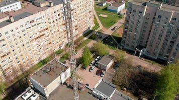 Cell Tower Urban environment residential buildings. Aerial shooting from the drone video