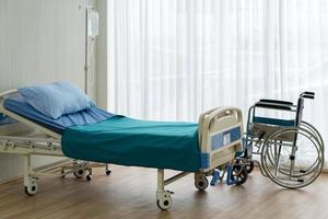 Bed and wheelchair in the hospital photo