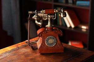 Old vintage retro telephone station. Great interior object. Old fashioned telephone. Vintage red phone. photo