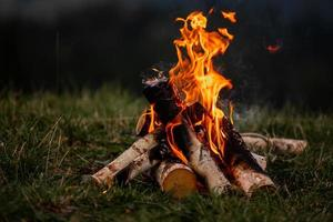 Burning bonfire in the evening in the Carpathian mountains. Place for inscription photo